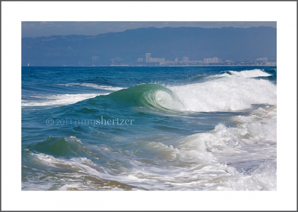 Southern California coast line with the perfect blue wave.