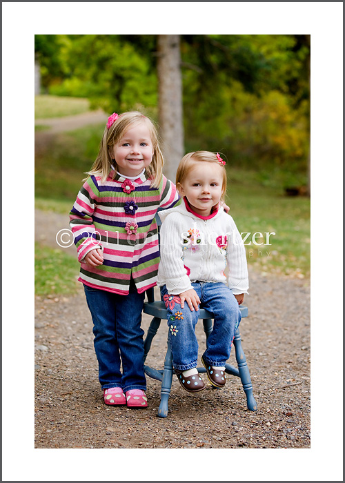 Los Angeles family photographer takes a picture of cute young sisters.