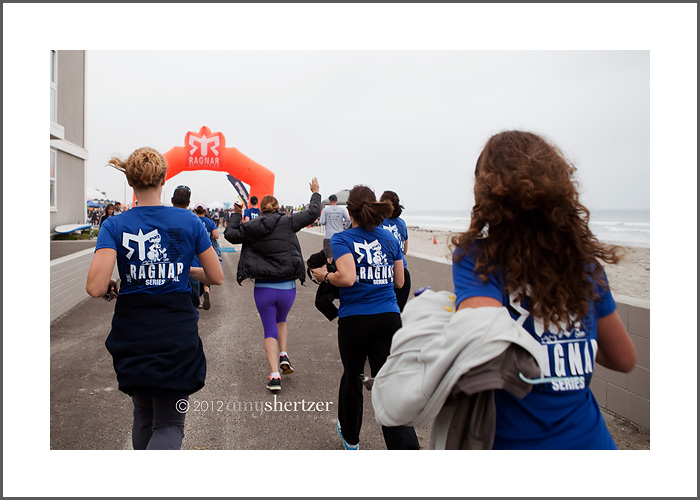 A victorious team runs toward the finish line of Ragnar SoCal 2012.