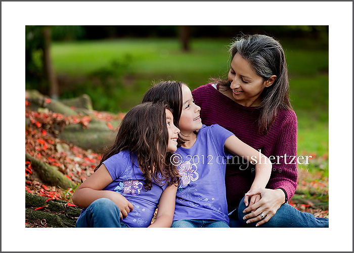 Two daughters smile lovingly at their mother in an El Segundo, CA photo shoot.