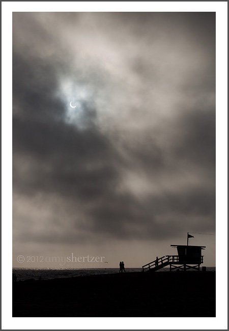The eclipse on May 20, 2012 as viewed from Los Angeles County beaches. The cloudy marine layer made an interesting natural filter of the sun.