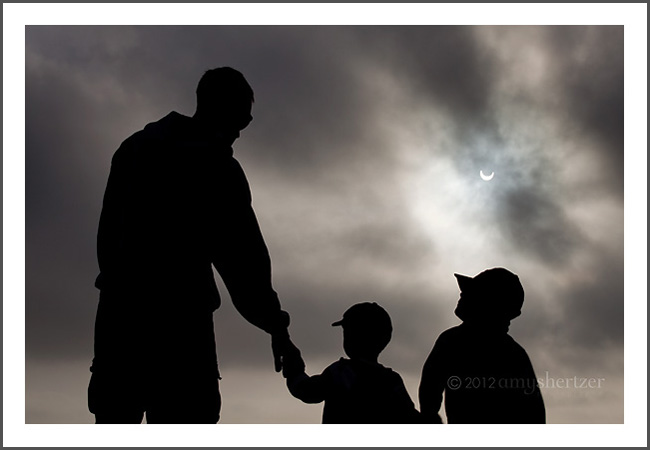 A father and his two sons view the May 20, 2012 solar eclipse from Los Angeles.