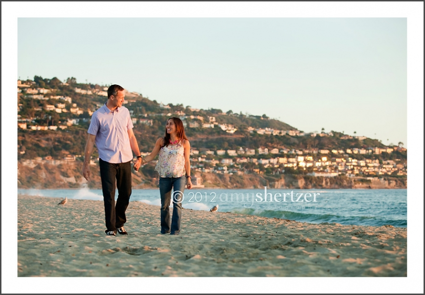 Couple walking on the beach in California.