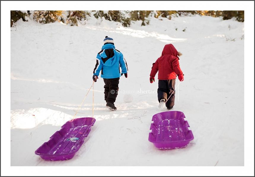 Sledding in the snow.